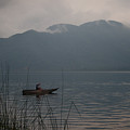 Fisherman Baiting Line Lake Atitlan Guatemala by Douglas Barnett