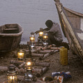 Fisherman Prepares Lanterns For Night by Michael S. Lewis