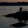 Fishermen Silhouetted By The Sunset by Todd Gipstein
