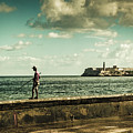 Fishing Along The Malecon by Lou Novick