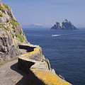 Fishing Boat Approaching Skellig Michael, County Kerry, In Spring Sunshine, Ireland by Peter Barritt