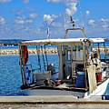 Fishing Boat Moored In The Harbor Of Katakolon Greece by Richard Rosenshein
