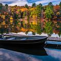 Fishing Boat On Mirror Lake by Rikk Flohr