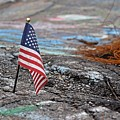 Flag In A Crack In The Pavement by Ben Schumin