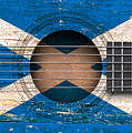 Flag Of Scotland On An Old Vintage Acoustic Guitar by Jeff Bartels