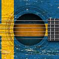 Flag Of Sweden On An Old Vintage Acoustic Guitar by Jeff Bartels