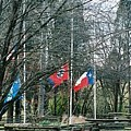 Flags At Sam Houston Schoolhouse by Linda A Waterhouse