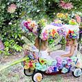 Flower Fairies In A Flower Mobile by Lise Winne