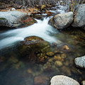 Flowing Between Boulders by Rick Strobaugh