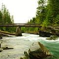 Flowing Under The Walkbridge by Jeff Swan