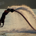 Flyboarder About To Enter Water With Hands by Ndp