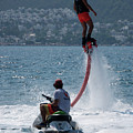 Flyboarder In Pink Shorts Above Jet Ski by Ndp