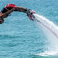 Flyboarder In Red Followed By Water Jet by Ndp