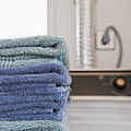 Folded Towels On A Dryer by Thom Gourley/Flatbread Images, LLC