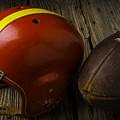 Football Helmet And Football by Garry Gay