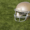 Football Helmet On Artificial Turf by SAJE Photography