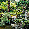 Footbridge Across A Pond, Kyoto by Panoramic Images