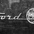 Ford F-100 Emblem On A Rusted Hood by Matthew Pace