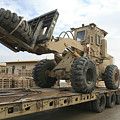 Forklift Is Unloaded Off Of A Logistics by Stocktrek Images