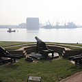 Fort Mchenry Cannons Over The Inner Harbor In Baltimore Maryland by William Kuta