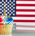 Fourth Of July Cupcake With Light Candle  by Thomas Baker