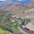 Freight Snaking Through Price Canyon Utah by Malcolm Howard