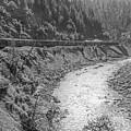 Freight Train Through Cow Creek Canyon, Oregon by Frank DiMarco