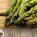 Fresh Asparagus On Napkin And Rustic Wood  by Thomas Baker