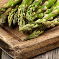 Fresh Asparagus On Rustic Wooden Server Board by Thomas Baker