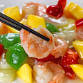 Fresh Shrimp And Peppers On White Serving Plate Ready To Eat by Thomas Baker