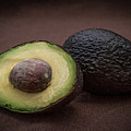 Fresh Whole And Half Avocado by Ray Sheley
