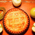 Freshly Baked Pie Surrounded By Apples On Table by Jorgo Photography - Wall Art Gallery