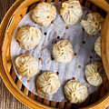 Freshly Cooked Dumplings Inside Of Bamboo Steamer Ready To Eat  by Thomas Baker