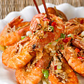 Fried Bread Coated Shrimp And Garnishes On White Serving Plate R by Thomas Baker