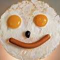 Fried Breakfast Of Eggs And Sausage Made Into A Smiling Face by Sami Sarkis