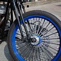 Front Wheel With Blue Rims And Fat Chrome Spokes Of Vintage Styl by Jason Rosette