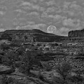 Full Moon Over Red Cliffs Bw by Mitch Johanson