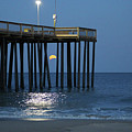 Full Worm Moon Thru The Pier by Robert Banach