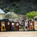 Antique Gas Pumps All In A Row by Sabrina L Ryan
