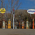 Gas Pumps And Gas Signs Panorama by Nick Gray