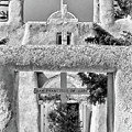 Gate To Ranchos Church Black And White by Charles Muhle