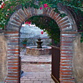 Gate To The Sacred Garden And Bell Wall Mission San Juan Capistrano California by Karon Melillo DeVega