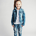 Girl In Jeans Clothes On White Background. by Michal Bednarek
