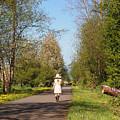 Girl On Trail In Straw Hat by Nancy Clendaniel