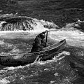 Girl Paddling An Open Canoe In Rapids by Les Palenik