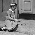 Girl Playing Jacks, C.1930-40s by H. Armstrong Roberts/ClassicStock