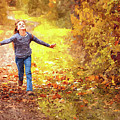 Girl Running In The Autumn Leaves by Movie Poster Prints