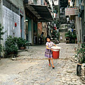 Girl With Laundry Basket by Maro Kentros