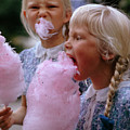 Girls Eat Large Swirls Of Cotton Candy by Gilbert M Grosvenor