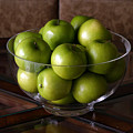 Glass Bowl Of Green Apples  by Michael Ledray